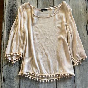 Women's cream 3/4 sleeve top with Pom Pom trim
